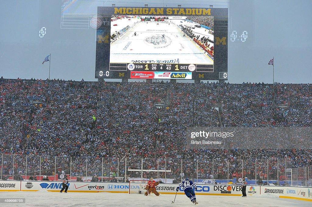 Tyler Bozak of the Toronto Maple Leafs skates in on goaltender Jimmy Howard of the Detroit Red Wings during shootout overtime of the 2014 Bridgestone...