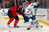 Tyler Bozak of the Toronto Maple Leafs skates with the puck against Dmitry Kulikov of the Florida Panthers at the BBT Center on December 28 2014 in...