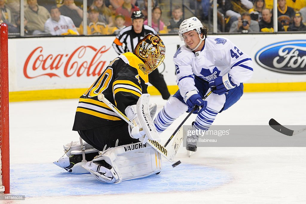 <a gi-track='captionPersonalityLinkClicked' href=/galleries/search?phrase=Tyler+Bozak&family=editorial&specificpeople=6183313 ng-click='$event.stopPropagation()'>Tyler Bozak</a> #42 of the Toronto Maple Leafs with the puck against <a gi-track='captionPersonalityLinkClicked' href=/galleries/search?phrase=Tuukka+Rask&family=editorial&specificpeople=716723 ng-click='$event.stopPropagation()'>Tuukka Rask</a> #40 of the Boston Bruins in Game One of the Eastern Conference Quarterfinals during the 2013 NHL Stanley Cup Playoffs at TD Garden on May 1, 2013 in Boston, Massachusetts.