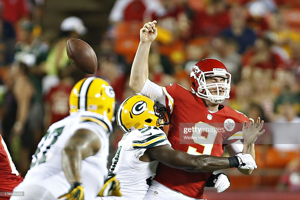 <a gi-track='captionPersonalityLinkClicked' href=/galleries/search?phrase=Tyler+Bray&family=editorial&specificpeople=7245348 ng-click='$event.stopPropagation()'>Tyler Bray</a> #9 of the Kansas City Chiefs is tackled by Nate Palmer #51 of the Green Bay Packers during the last preseason game at Arrowhead Stadium on August 29, 2013 in Kansas CIty, Missouri.