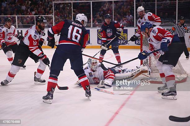 Tyler Bunz of Canada saves a shot on goal during the 2015 Ice Hockey Classic match between the Unites States and Canada at Allphones Arena on June 6...