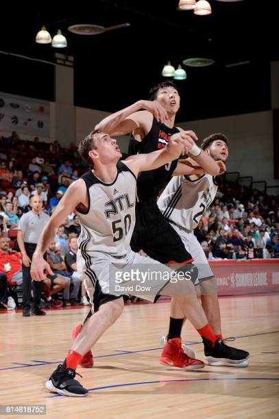 Tyler Cavanaugh and Isaia Cordinier of the Atlanta Hawks box out Zhou Qi of the Houston Rockets during the 2017 Summer League on July 14 2017 at Cox...