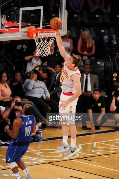 Tyler Cavanaugh of the Atlanta Hawks goes to the basket against the Dallas Mavericks on October 12 2017 at McCamish Pavilion in Atlanta Georgia NOTE...