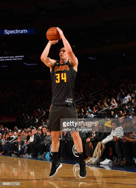Tyler Cavanaugh of the Atlanta Hawks shoots the ball against the New York Knicks at Madison Square Garden on December 10 2017 in New York New York...