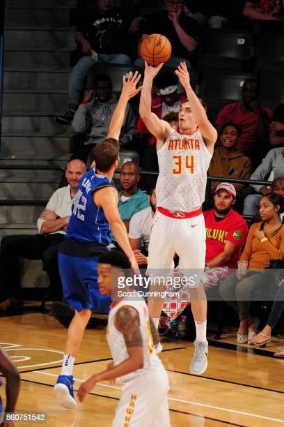 Tyler Cavanaugh of the Atlanta Hawks shoots the ball against the Dallas Mavericks on October 12 2017 at McCamish Pavilion in Atlanta Georgia NOTE TO...
