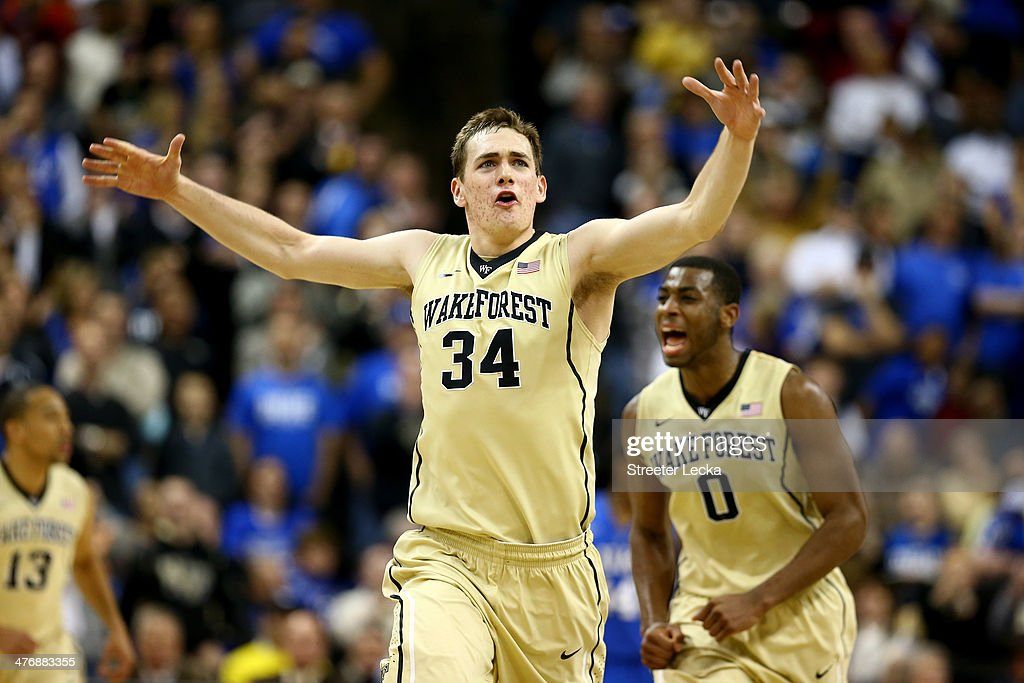 Tyler Cavanaugh of the Wake Forest Demon Deacons reacts after hitting a shot with teammate Codi MillerMcIntyre during their game against the Duke...