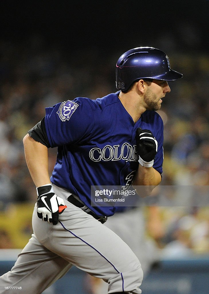 Tyler Chatwood #32 of the Colorado Rockies runs to first base after hitting a two RBI single in the fourth inning against the Los Angeles Dodgers at Dodger Stadium on April 29, 2013 in Los Angeles, California.