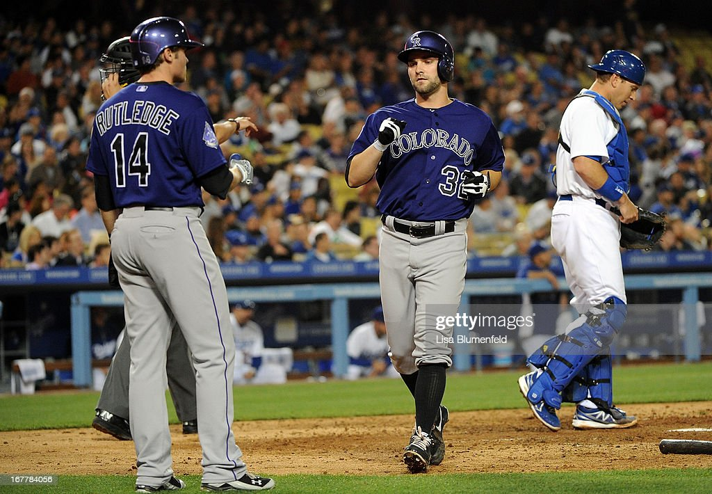 Tyler Chatwood #32 of the Colorado Rockies scores in the fourth inning against the Los Angeles Dodgers at Dodger Stadium on April 29, 2013 in Los Angeles, California.