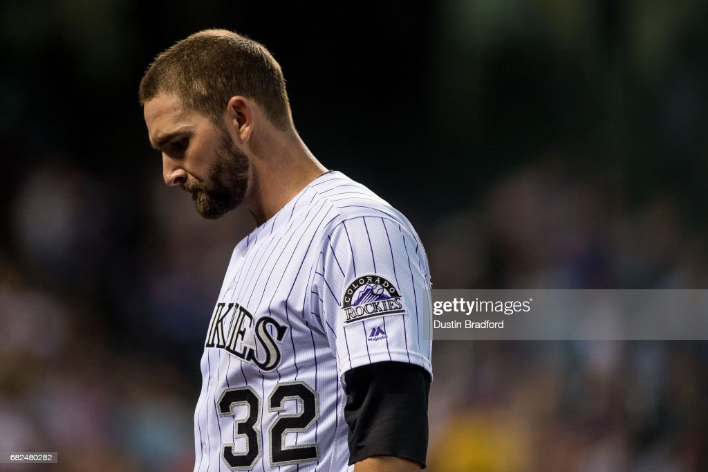 Tyler Chatwood #32 of the Colorado Rockies walks off the field after being pulled in the 5th inning of a game against the Los Angeles Dodgers at Coors Field on May 12, 2017 in Denver, Colorado.