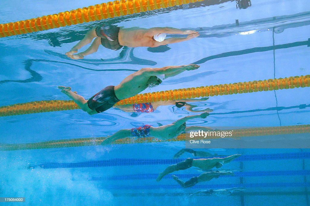 Tyler Clary and Tom Luchsinger of the USA compete during the Swimming Men's 200m Butterfly Semifinal on day eleven of the 15th FINA World...