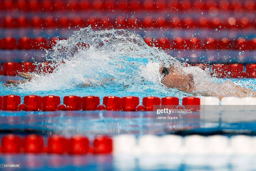 Tyler Clary competes in the first semifinal heat of the Men's 200 m Backstroke during Day Five of the 2012 US Olympic Swimming Team Trials at...