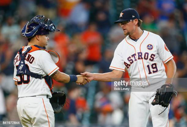 Tyler Clippard of the Houston Astros shakes hands with Juan Centeno after the final out as the Houston Astros defeated the New York Mets 128 at...