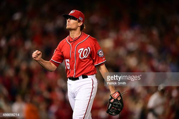 Tyler Clippard of the Washington Nationals celebrates a call in the tenth inning against the San Francisco Giants during Game Two of the National...