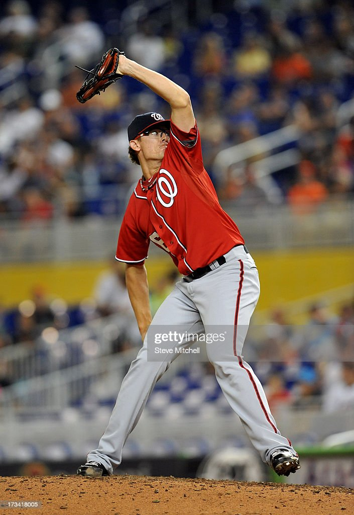 Tyler Clippard #36 of the Washington Nationals delivers a pitch during the eighth inning against the Miami Marlins at Marlins Park on July 13, 2013 in Miami, Florida.