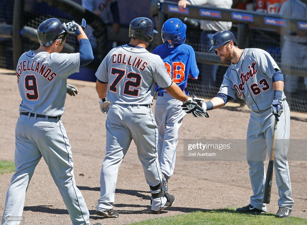 Tyler Collins #72 is congratulated by <a gi-track='captionPersonalityLinkClicked' href=/galleries/search?phrase=Trevor+Crowe&family=editorial&specificpeople=836223 ng-click='$event.stopPropagation()'>Trevor Crowe</a> #63 of the Detroit Tigers after hitting a two run home run against the New York Mets in the third inning during a spring training game at Tradition Field on March 18, 2014 in Port St. Lucie, Florida.