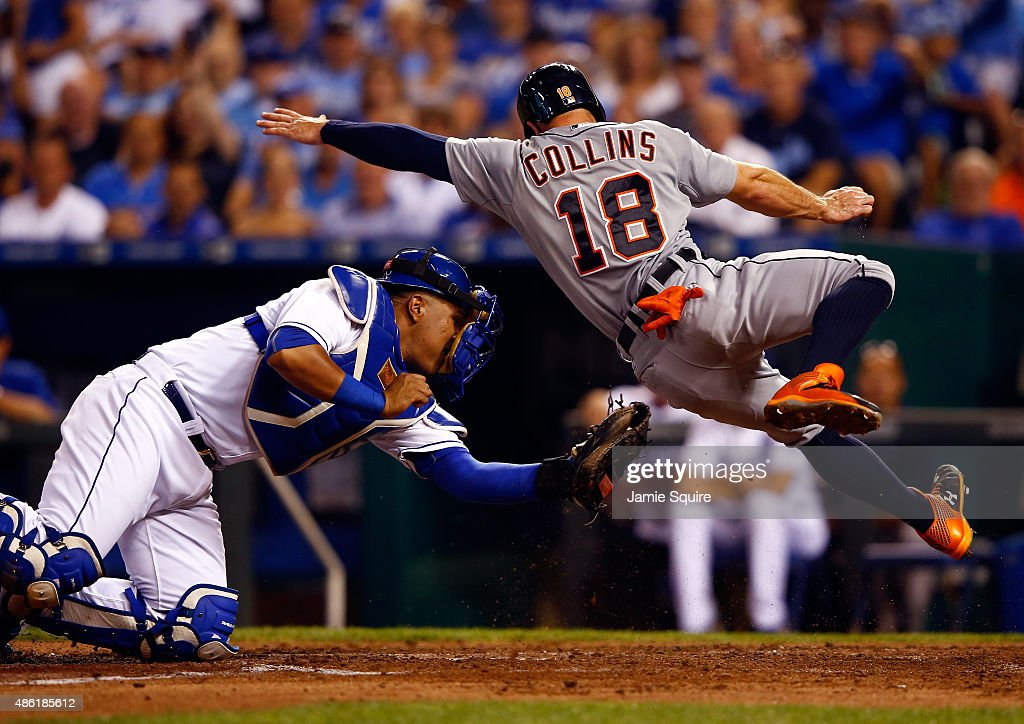 Tyler Collins #18 of the Detroit Tigers is tagged out at home plate by Salvador Perez #13 of the Kansas City Royals during the game at Kauffman Stadium on September 1, 2015 in Kansas City, Missouri.