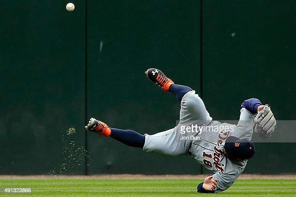 Tyler Collins of the Detroit Tigers is unable to field a triple by Trayce Thompson of the Chicago White Sox during the fourth inning at US Cellular...