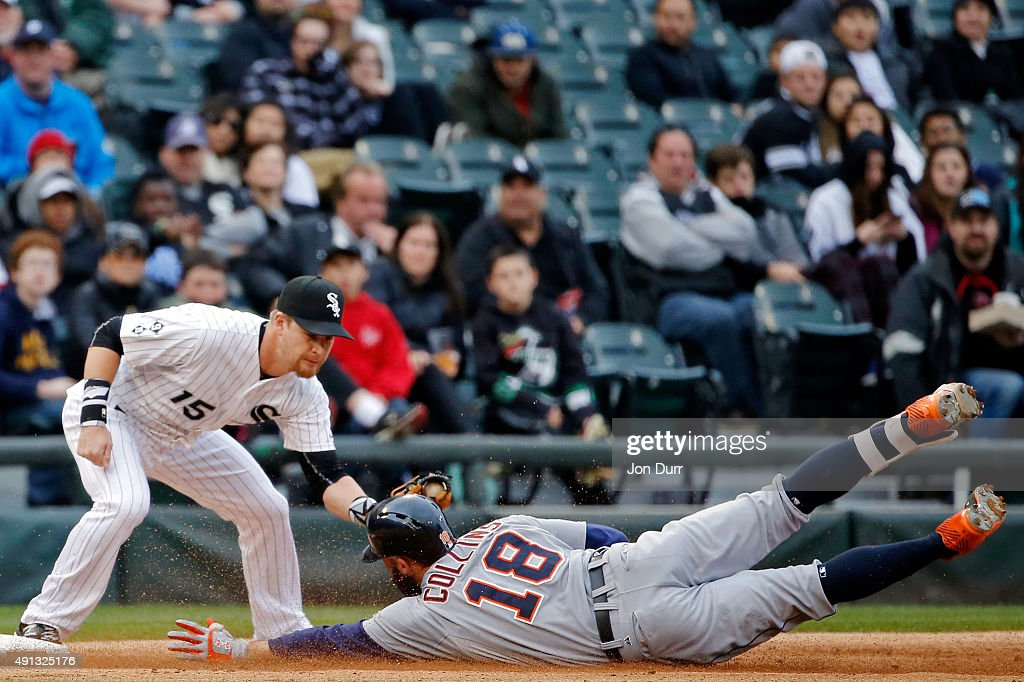 Tyler Collins #18 of the Detroit Tigers slides safely into third base on a three run RBI triple as Gordon Beckham #15 of the Chicago White Sox applies the tag during the seventh inningat U.S. Cellular Field on October 4, 2015 in Chicago, Illinois.