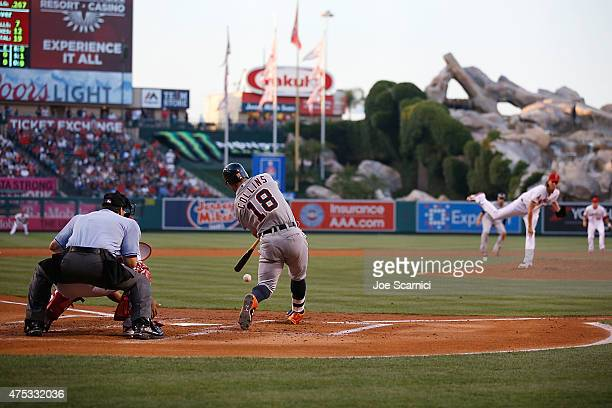 Tyler Collins of the Detroit Tigers swings for a strike thrown by Jered Weaver of the Los Angeles Angels in the second inning at Angel Stadium of...