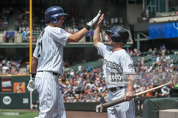 Tyler Colvin and the Colorado Rockies bat boy celebrate a first inning 2run Colvin home run against the Philadelphia Phillies at Coors Field on June...