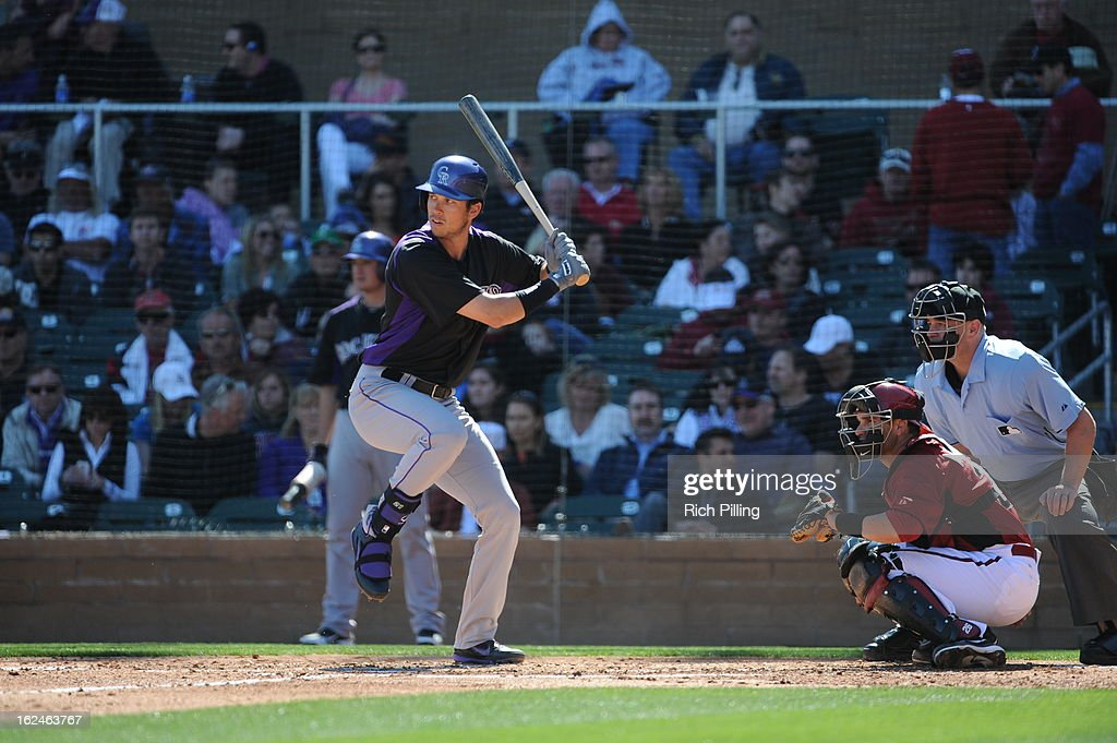 <a gi-track='captionPersonalityLinkClicked' href=/galleries/search?phrase=Tyler+Colvin&family=editorial&specificpeople=4175115 ng-click='$event.stopPropagation()'>Tyler Colvin</a> #21 of the Colorado Rockies bats during the game against the Arizona Diamondbacks on February 23, 2013 at the Salt River Fields at Talking Stick in Scottsdale, Arizona. The Rockies defeated the Diamondbacks 11-2.