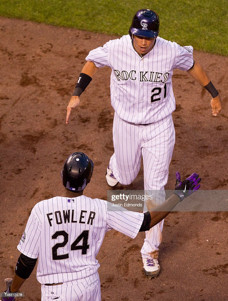 <a gi-track='captionPersonalityLinkClicked' href=/galleries/search?phrase=Tyler+Colvin&family=editorial&specificpeople=4175115 ng-click='$event.stopPropagation()'>Tyler Colvin</a> #21 of the Colorado Rockies celebrates with <a gi-track='captionPersonalityLinkClicked' href=/galleries/search?phrase=Dexter+Fowler&family=editorial&specificpeople=4949024 ng-click='$event.stopPropagation()'>Dexter Fowler</a> #24 after scoring the go-ahead run in the sixth inning against the Philadelphia Phillies at Coors Field on July 13, 2012 in Denver, Colorado. The Rockies defeated the Phillies 6-2.