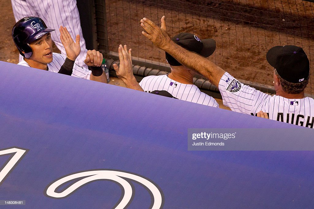 <a gi-track='captionPersonalityLinkClicked' href=/galleries/search?phrase=Tyler+Colvin&family=editorial&specificpeople=4175115 ng-click='$event.stopPropagation()'>Tyler Colvin</a> #21 of the Colorado Rockies is greeted in the dugout after scoring the go-ahead run in the sixth inning against the Philadelphia Phillies at Coors Field on July 13, 2012 in Denver, Colorado.