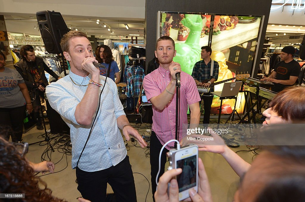 Tyler Cordy (L) and Marc Griffin of the band 2AM Club perform as Sportiqe and ESPN host a NBA Playoff Party at Bloomingdale's 59th Street Store on April 25, 2013 in New York City.