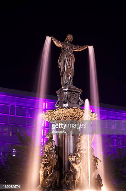 Tyler Davidson Fountain lit up at night