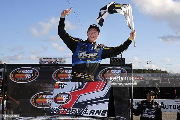 Tyler Dippel driver of the East West Marine/TyCar Chevrolet celebrates after winning the NASCAR KN Pro Series East Mobile 150 on March 13 2016 in...