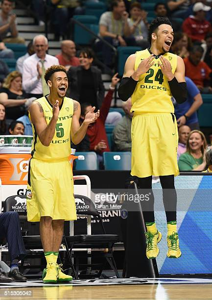 Tyler Dorsey and Dillon Brooks of the Oregon Ducks celebrate their 8857 victory over the Utah Utes to win the championship game of the Pac12...