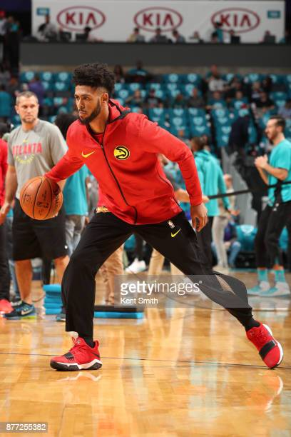 Tyler Dorsey of the Atlanta Hawks warms up before the game against the Charlotte Hornets on October 20 2017 at Spectrum Center in Charlotte North...