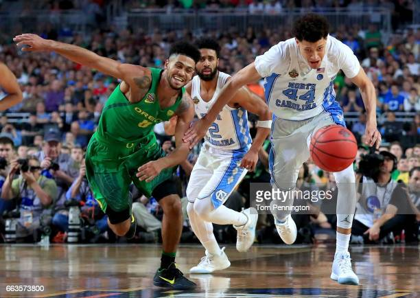Tyler Dorsey of the Oregon Ducks and Justin Jackson of the North Carolina Tar Heels compete for the ball in the second half during the 2017 NCAA...