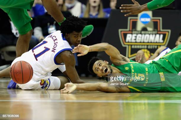 Tyler Dorsey of the Oregon Ducks battles for the loose ball with Josh Jackson of the Kansas Jayhawks in the second half during the 2017 NCAA Men's...