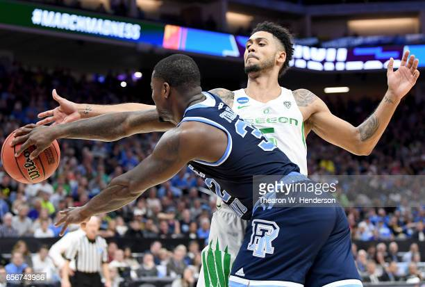 Tyler Dorsey of the Oregon Ducks defends the pass of Jared Terrell of the Rhode Island Rams during the second round of the 2017 NCAA Men's Basketball...