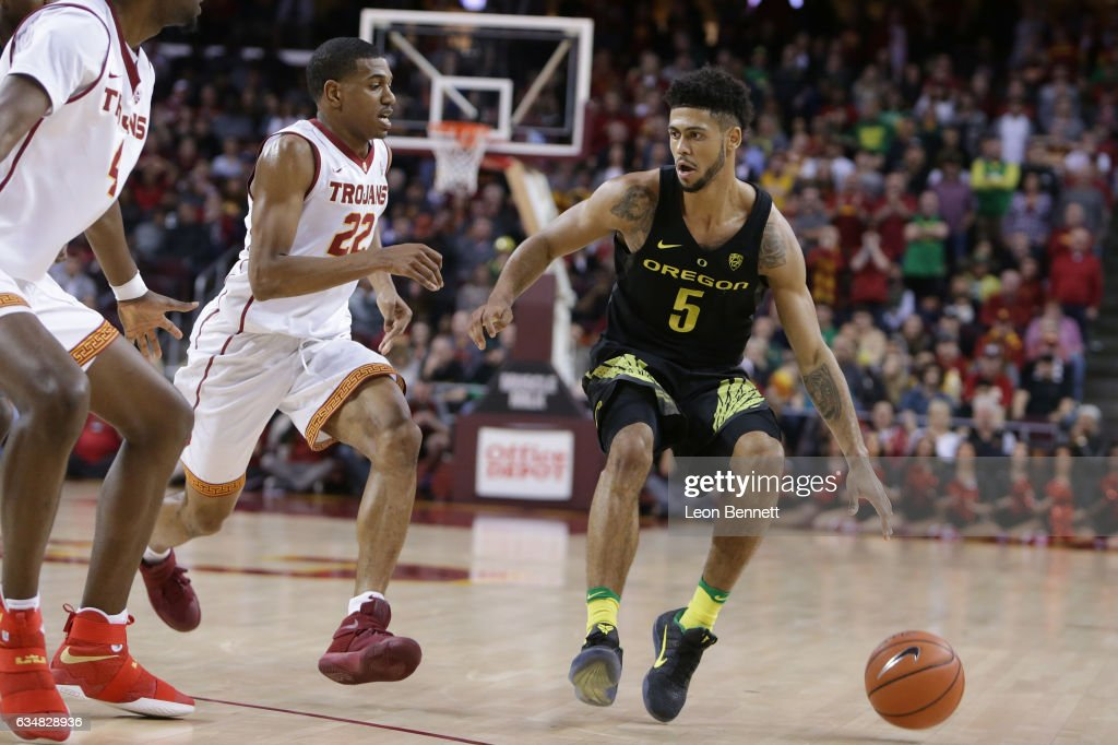Tyler Dorsey #5 of the Oregon Ducks handles the ball against De'Anthony Melton 322 of the USC Trojans during a Pac12 confernce college basketball game at Galen Center on February 11, 2017 in Los Angeles, California.