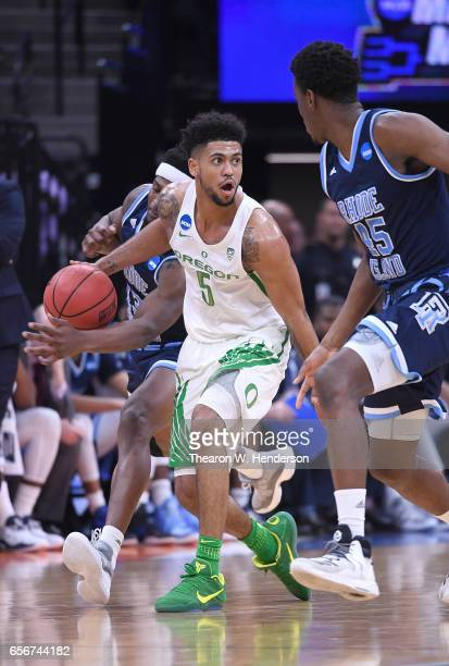 Tyler Dorsey of the Oregon Ducks loses control of the ball to Stanford Robinson of the Rhode Island Rams during the second round of the 2017 NCAA...