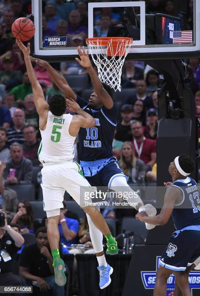 Tyler Dorsey of the Oregon Ducks shoots over Cyril Langevine of the Rhode Island Rams during the second round of the 2017 NCAA Men's Basketball...