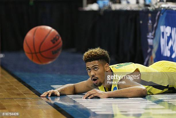 Tyler Dorsey of the Oregon Ducks watches the ball from the ground after he fought to keep it in bounds in the second half against the Saint Joseph's...
