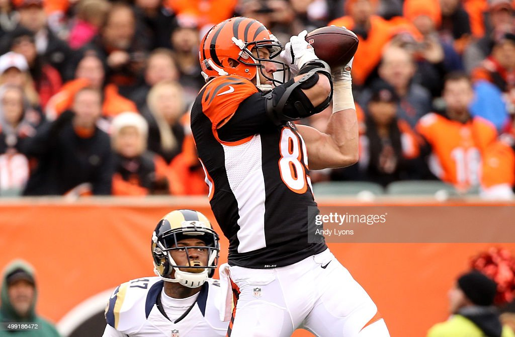 <a gi-track='captionPersonalityLinkClicked' href=/galleries/search?phrase=Tyler+Eifert&family=editorial&specificpeople=6258359 ng-click='$event.stopPropagation()'>Tyler Eifert</a> #85 of the Cincinnati Bengals makes a catch in front of <a gi-track='captionPersonalityLinkClicked' href=/galleries/search?phrase=Marcus+Roberson&family=editorial&specificpeople=3727435 ng-click='$event.stopPropagation()'>Marcus Roberson</a> #47 of the St. Louis Rams at Paul Brown Stadium on November 29, 2015 in Cincinnati, Ohio.