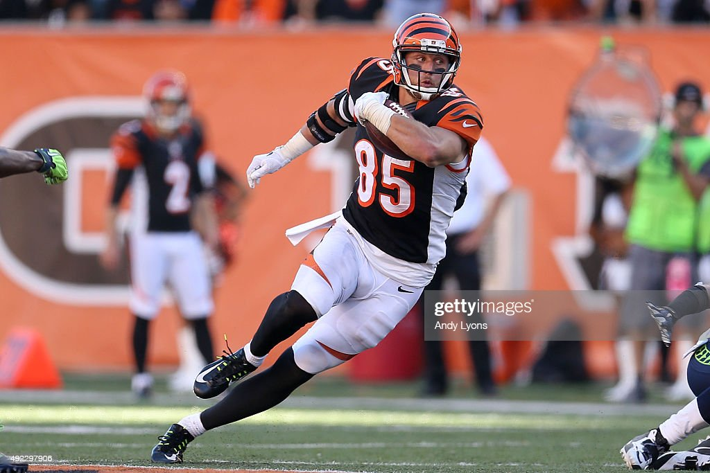 <a gi-track='captionPersonalityLinkClicked' href=/galleries/search?phrase=Tyler+Eifert&family=editorial&specificpeople=6258359 ng-click='$event.stopPropagation()'>Tyler Eifert</a> #85 of the Cincinnati Bengals runs after catching a pass during overtime against the Seattle Seahawks at Paul Brown Stadium on October 11, 2015 in Cincinnati, Ohio. Cincinnati defeated Seattle 27-24 in overtime.