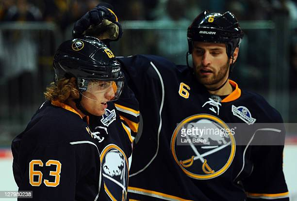 Tyler Ennis of Buffalo celebrates with team mate Mike Weber after scoring his teams second goal during the NHL PreSeason match between Buffalo Sabres...