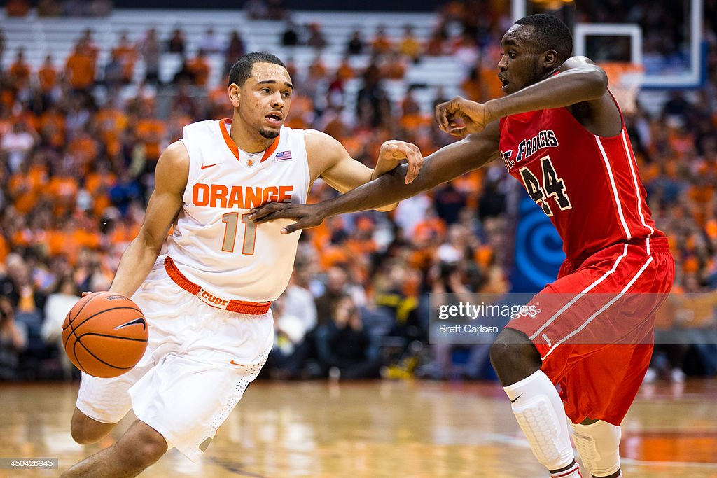 Tyler Ennis #11 of Syracuse Orange is defended by Anthony White #44 of St Francis Terriers during the first half of a basketball game on November 18, 2013 at the Carrier Dome in Syracuse, New York.