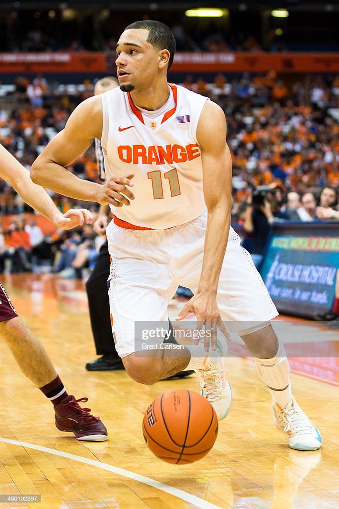 Tyler Ennis #11 of Syracuse Orange works his way around the outside of the three point line during a basketball game against Colgate Raiders on November 16, 2013 at the Carrier Dome in Syracuse, New York. Syracuse defeated Colgate 69-50.