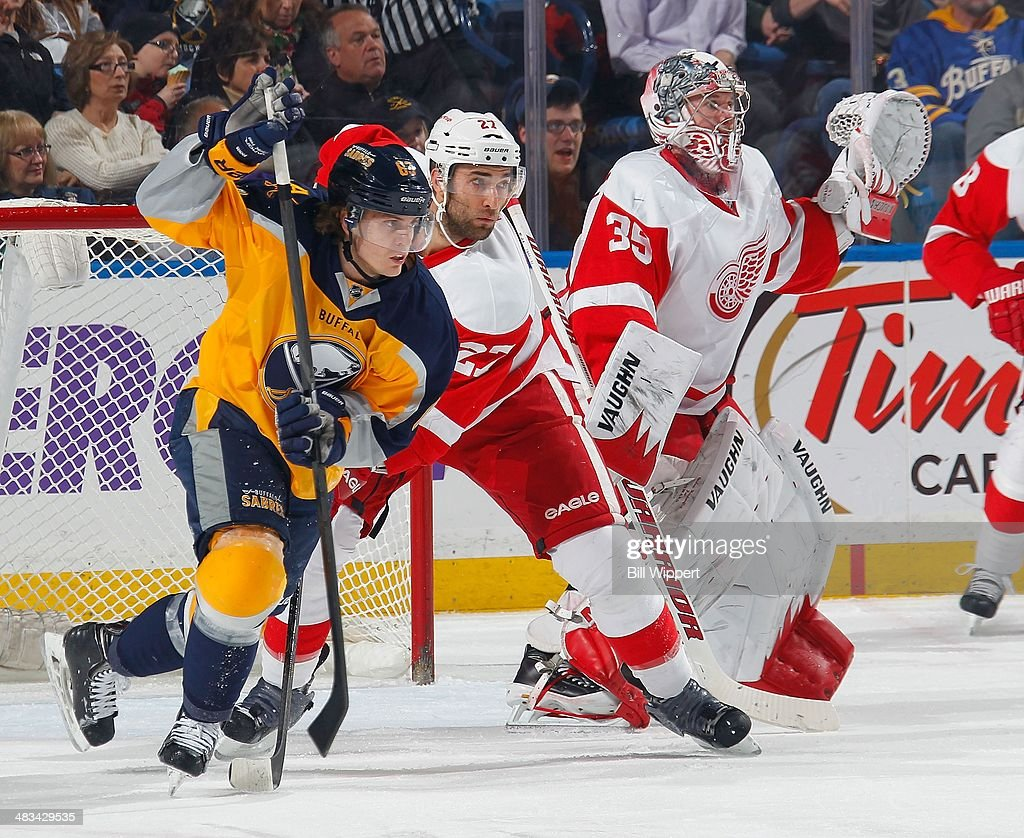 Tyler Ennis #63 of the Buffalo Sabres battles for position with Kyle Quincy #27 of the Detroit Red Wings alongside Detroit goaltender <a gi-track='captionPersonalityLinkClicked' href=/galleries/search?phrase=Jimmy+Howard&family=editorial&specificpeople=2118637 ng-click='$event.stopPropagation()'>Jimmy Howard</a> #35 on April 8, 2014 at the First Niagara Center in Buffalo, New York.