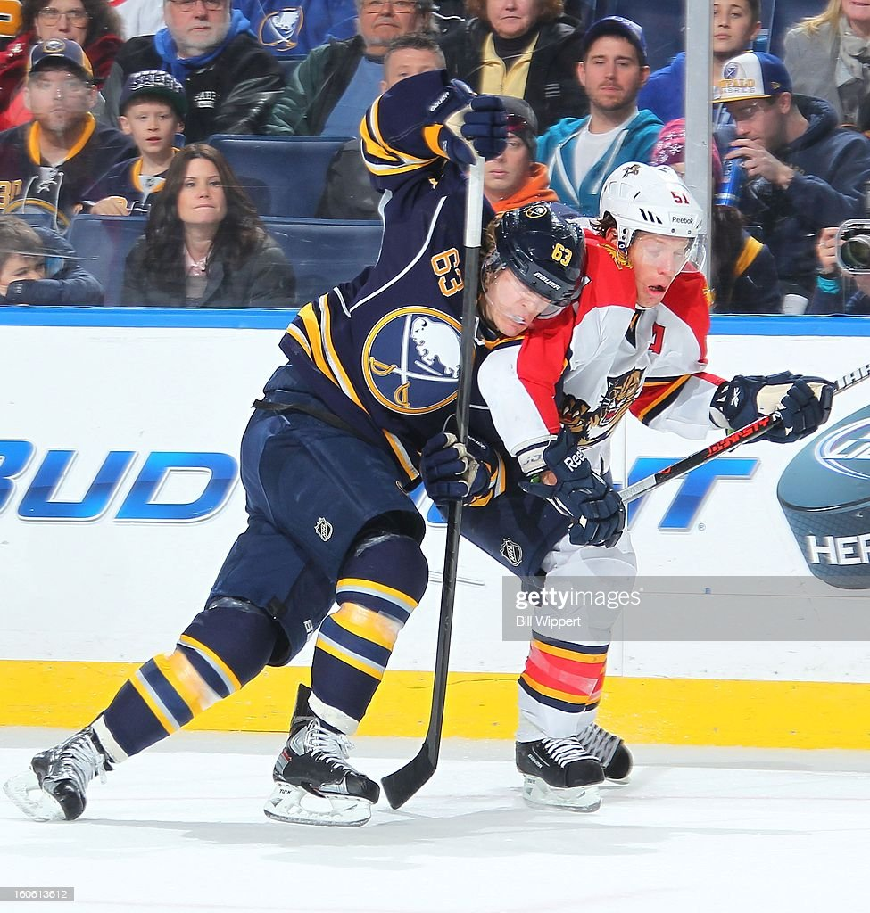 Tyler Ennis #63 of the Buffalo Sabres battles for the puck with Brian Campbell #51 of the Florida Panthers on February 3, 2013 at the First Niagara Center in Buffalo, New York.
