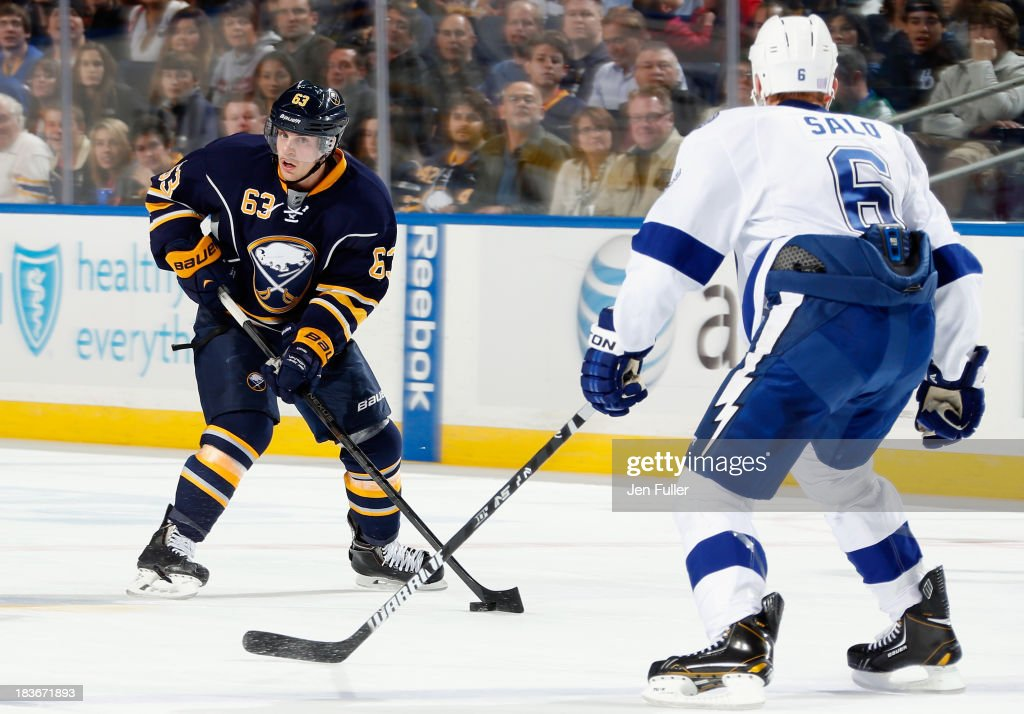 <a gi-track='captionPersonalityLinkClicked' href=/galleries/search?phrase=Tyler+Ennis+-+Ice+Hockey+Player&family=editorial&specificpeople=4754184 ng-click='$event.stopPropagation()'>Tyler Ennis</a> #63 of the Buffalo Sabres carries the puck against <a gi-track='captionPersonalityLinkClicked' href=/galleries/search?phrase=Sami+Salo&family=editorial&specificpeople=206132 ng-click='$event.stopPropagation()'>Sami Salo</a> #6 of the Tampa Bay Lightning at First Niagara Center on October 8, 2013 in Buffalo, New York. Tampa defeated Buffalo 3-2.