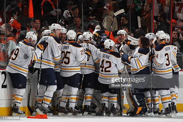 Tyler Ennis of the Buffalo Sabres celebrates with teammates after scoring the game winning goal in overtime in Game Five of the Eastern Conference...