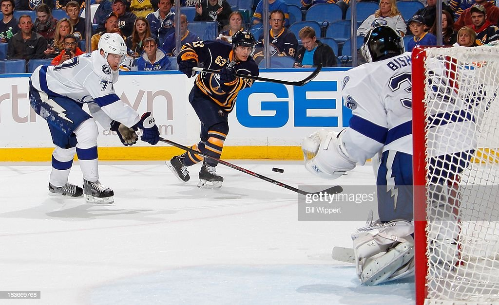 <a gi-track='captionPersonalityLinkClicked' href=/galleries/search?phrase=Tyler+Ennis+-+Ice+Hockey+Player&family=editorial&specificpeople=4754184 ng-click='$event.stopPropagation()'>Tyler Ennis</a> #63 of the Buffalo Sabres fires an overtime shot towards goaltender <a gi-track='captionPersonalityLinkClicked' href=/galleries/search?phrase=Ben+Bishop&family=editorial&specificpeople=700137 ng-click='$event.stopPropagation()'>Ben Bishop</a> #30 of the Tampa Bay Lightning while defended by <a gi-track='captionPersonalityLinkClicked' href=/galleries/search?phrase=Victor+Hedman&family=editorial&specificpeople=4784238 ng-click='$event.stopPropagation()'>Victor Hedman</a> #77 on October 8, 2013 at the First Niagara Center in Buffalo, New York. Tampa Bay won, 3-2.