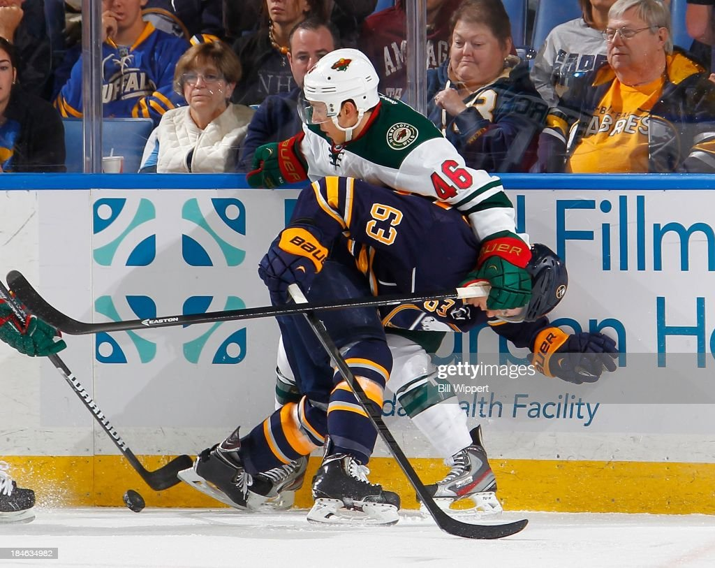 <a gi-track='captionPersonalityLinkClicked' href=/galleries/search?phrase=Tyler+Ennis+-+Ice+Hockey+Player&family=editorial&specificpeople=4754184 ng-click='$event.stopPropagation()'>Tyler Ennis</a> #63 of the Buffalo Sabres gets handled along the boards by <a gi-track='captionPersonalityLinkClicked' href=/galleries/search?phrase=Jared+Spurgeon&family=editorial&specificpeople=4594192 ng-click='$event.stopPropagation()'>Jared Spurgeon</a> #46 of the Minnesota Wild on October 14, 2013 at the First Niagara Center in Buffalo, New York.